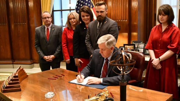 Missouri's governor signs bill that bans abortion after 8 weeks