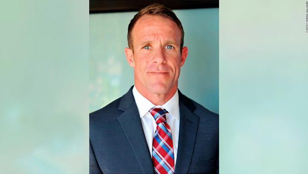In the first week of testimony against a Navy SEAL accused of murder, witnesses said he also took photos with a corpse and shot at unarmed civilians